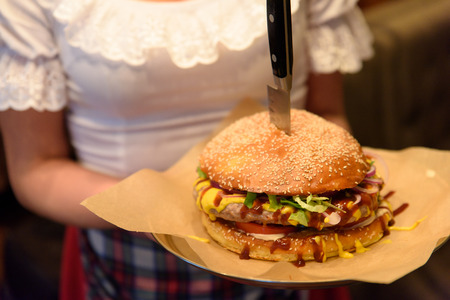 Hamburger served by waitress