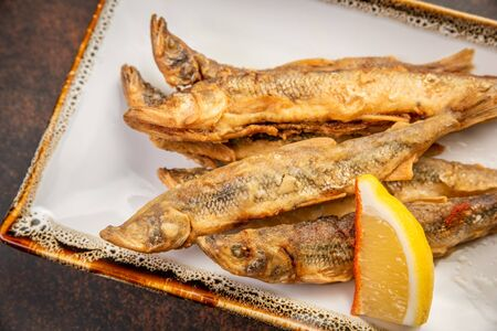 Crispy deep-fried small fish with lemon