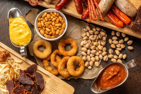 Assortment of beer snacks close up on counter Stock Photo