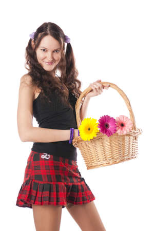 Schoolgirl with a flowers basket. Isolated over white. Stock Photo