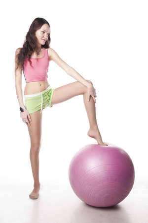 Sport girl and ball. Isolated over white.