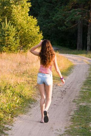 girl walks on a footpath