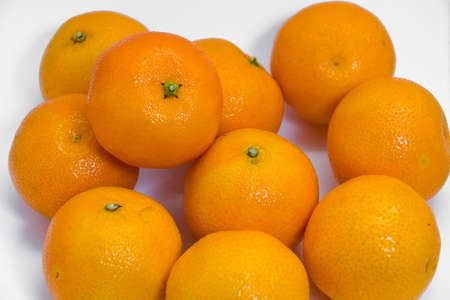 Tangerines on the white background