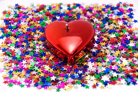 Valentine Day, Heart against confetti (candle) photo