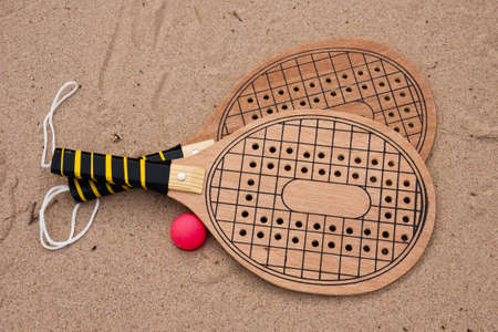 Rackets for game on a beach. (rackets and ball)