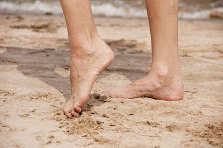 Feet of the girl on a beach