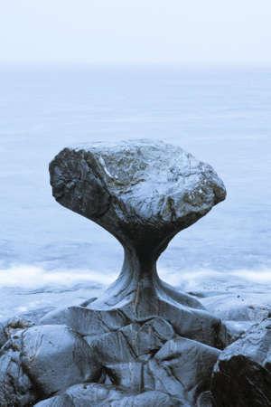 Unusual stone in Atlantic ocean coast. View on Kannesteinen and Kvalheimsvika.