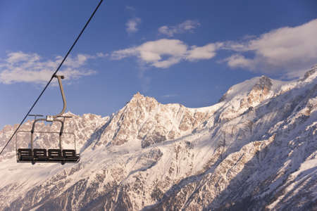 Four chair lifts on the Alps background. Stock Photo