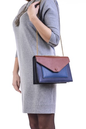 modish: woman holding a bag on a white background Stock Photo
