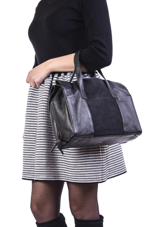 petticoat: woman holding a bag on a white background Stock Photo