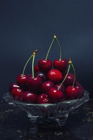 sweet background: Cherries in a saucer