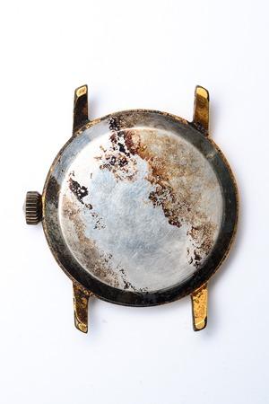 burned wristwatch on white background