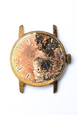 nonworking: burned wristwatch on white background