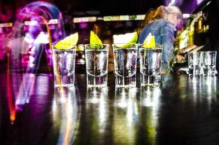 yellow to drink: four glasses with Lim on the bar at a nightclub