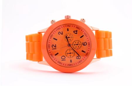 caoutchouc: uniskes orange clock on a white background Stock Photo