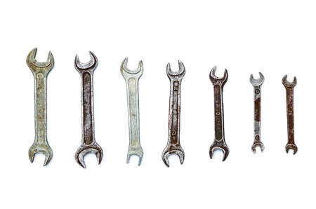 crescent wrench: set of old wrenches on a white background