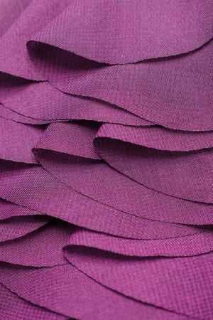 soft tissue: texture layering wavy purple fabric Stock Photo