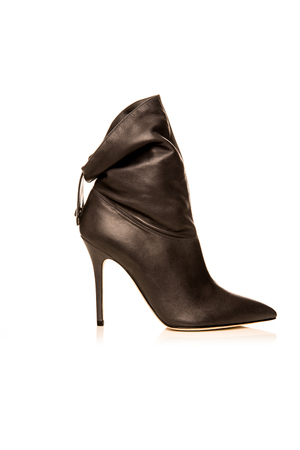 heelpiece: black female  boot on a white background