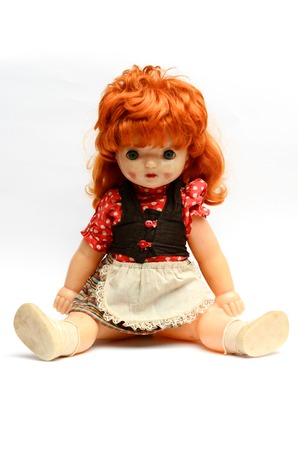 old plastic doll with red hair