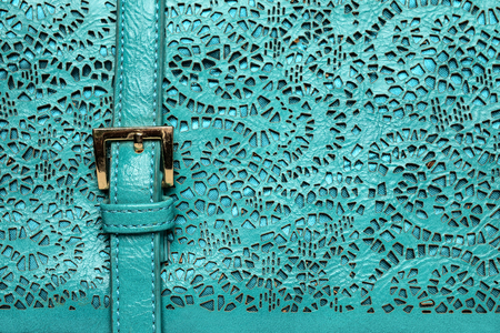 tooled: texture of carved leather, turquoise texture Stock Photo