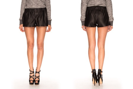 hessian boots: female legs in shorts and heels Stock Photo