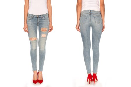 rip: female legs in blue jeans and red shoes Stock Photo