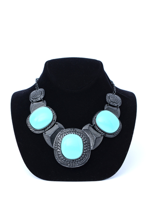 silver necklace with turquoise stones on mannequin isolated on white Stock Photo