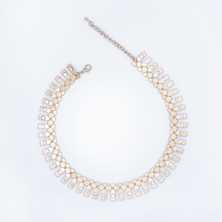 round collar: gold necklace isolated on white