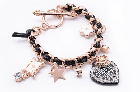 bracelet with pendants on a white background Imagens