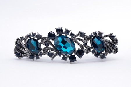 broach: brooch with blue stones isolated on white