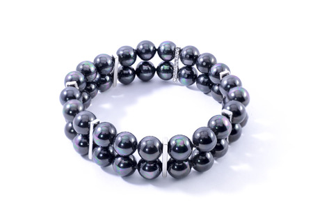 armlet: Bracelet with black pearls isolated on white