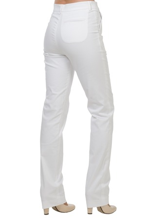 white pants: Female feet in the white pants isolated on white