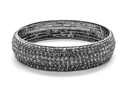 pietre preziose: black bracelet with precious stones on a white background Archivio Fotografico