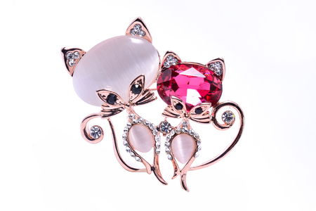 brooch with cats isolated on white Stock Photo