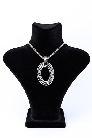 coulomb: oval pendant on a mannequin isolated on white