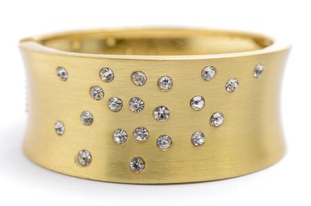 wristlet: gold bracelet with diamonds on a white background