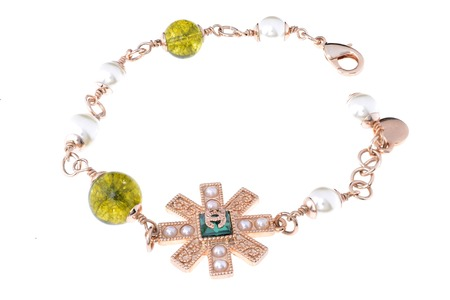 armlet: gold bracelet on a white background Stock Photo