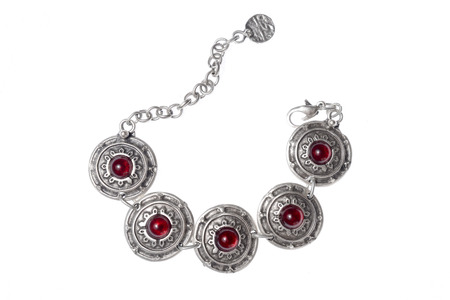 circlet: Silver bracelet with rubies on a white background