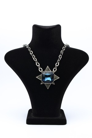 ladies bust: Pendant star  with blue stones on mannequin isolated on white