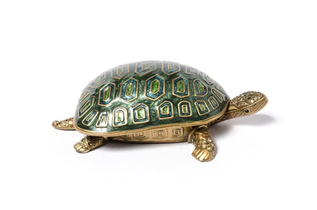 statuette: casket turtle isolated on white Stock Photo