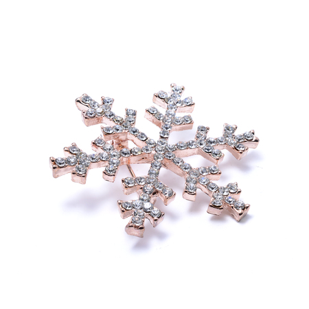 brooch: Snowflake brooch isolated on white