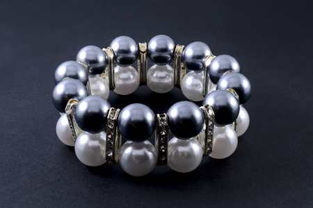 wristlet: bracelet with pearls isolated on black