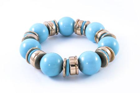 Bracelet with blue stones isolated on white