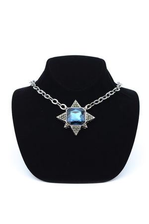 finery: Pendant star  with blue stones on mannequin isolated on white