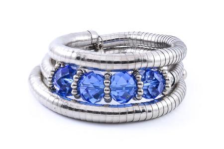 armlet: iron bracelet with blue stones isolated on white Stock Photo