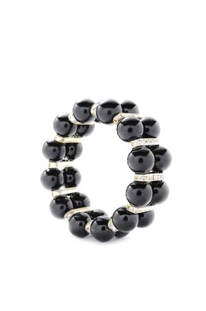 armlet: Black bracelet with beads on a white background Stock Photo