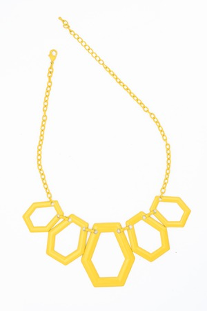 coulomb: Yellow geometric necklace isolated on white Stock Photo