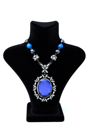 coulomb: Pendant with big blue stone on a mannequin isolated on white