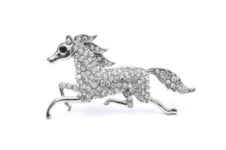 brooch horse isolated on a white Standard-Bild