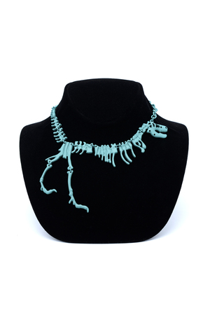 coulomb: necklace with a dinosaur on a mannequin isolated on white